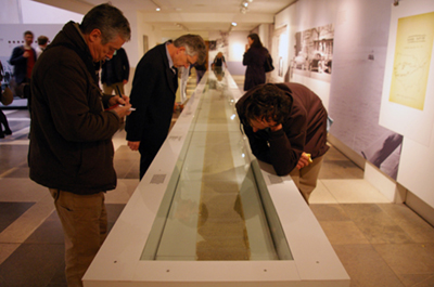 Visitors looking at the 'On The Road' scroll in it's case
