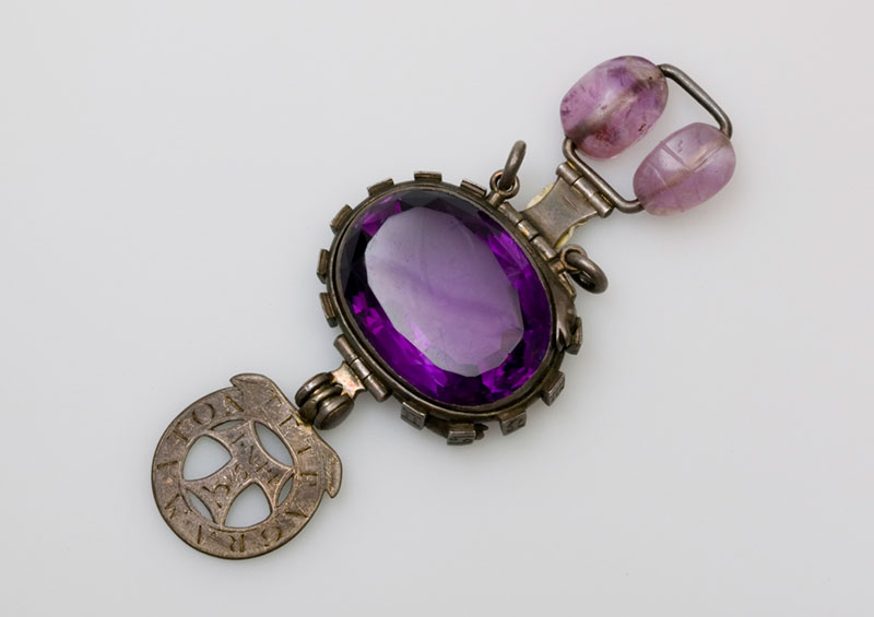 The 'cursed amethyst', mounted in silver with two hinged pendants