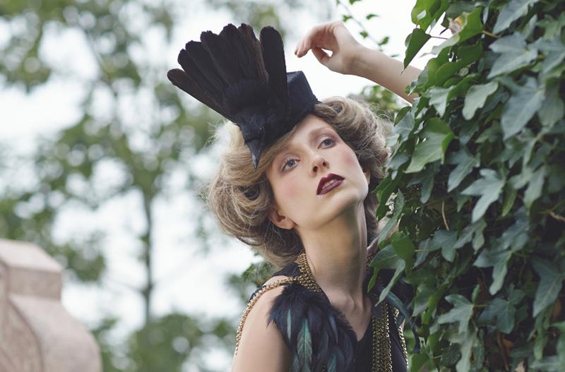 A model wearing a feathered headdress by Joanna Shears