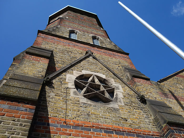 A pentagram on the exterior of St Barnabas at Bethnal Green
