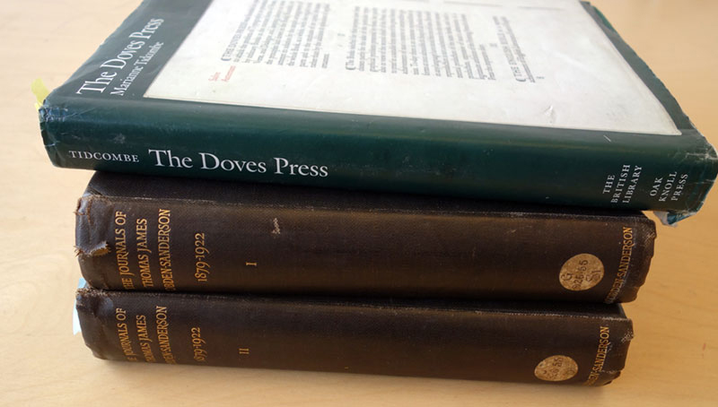 A stack of books about Doves Type and Thomas James Cobden-Sanderson