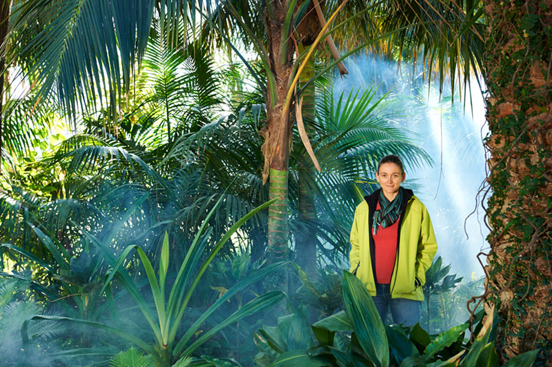 Portrait of Monica Gagliano standing in a misty rainforest